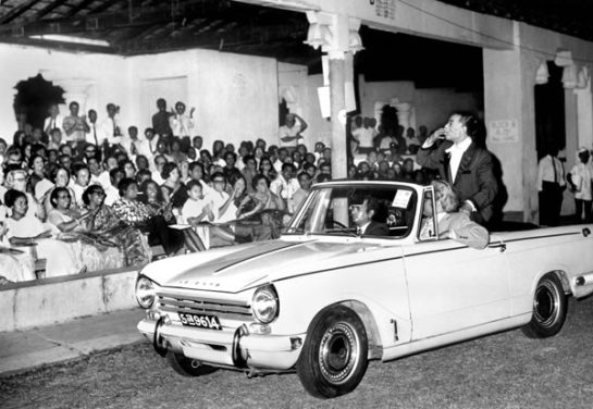 Duke Ellington arrives for his sell out concert in Colombo, Ceylon (now Sri Lanka) seated on a Triumph Herald. Sri Lankan broadcaster Vernon Corea and his family were in the audience in 1963.