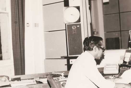 Vernon Corea broadcasting from a studio in the BBC.