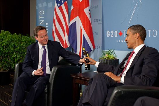 Britain's Prime Minister David Cameron here with US President Obama has been asked to recognise the historic broadcasting efforts of Edward Harper at CHOGM 2013.