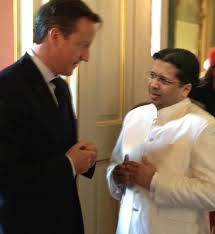 Britain's Prime Minister here with Sri Lanka's High Commissioner in the UK, Dr. Chris Nonis, will be flying to Colombo to attend CHOGM 2013. He has been asked to acknowledge the broadcasting efforts of a GREAT BRITON, Edward Harper.
