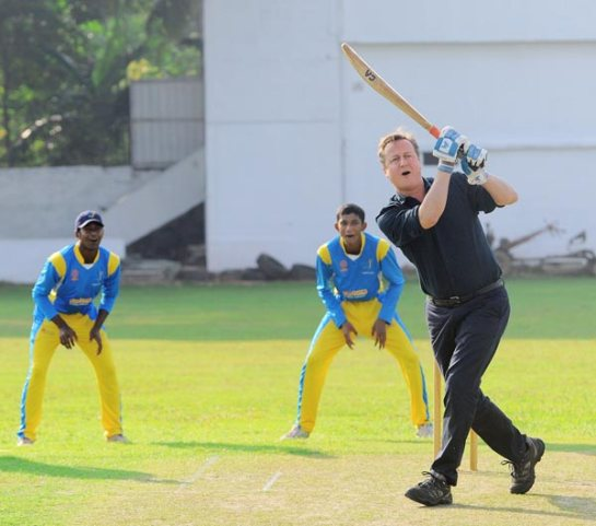 Prime Minister David Cameron hooks one off Muttiah Muralitharan at the Colombo Cricket Grounds.