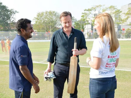 Muttiah Muralitharan - Sri Lanka's best ever spin bowler with Prime Minister David Cameron at the Colombo Cricket Grounds during CHOGM 2013.