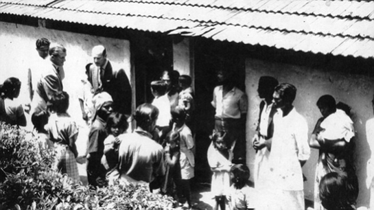 HRH Prince Phillip chats to estate workers at the Tea Estate during the Royal Visit to Ceylon in 1954. (Photo was published in the Daily Mail)