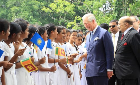 His Royal Highness Prince Charles, the Prince of Wales talking to Sri Lankan school children at the Colombo National Museum during CHOGM 2013.