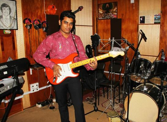 Rukshan Karunanayake, the Global Autism Award 2014 winner wearing his autism awareness ribbon in his recording studio in Sri Lanka.
