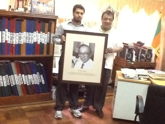 Chrismarlon Perera of the Radio Ceylon Facebook Group presents a framed picture of the legendary Sri Lankan broadcaster Vernon Corea to the Chairman of the Sri Lanka Broadcasting Corporation, Hudson Samarasinghe to commemorate Vernon  Corea's 12th Death Anniversary which falls on 23rd September 2014.
