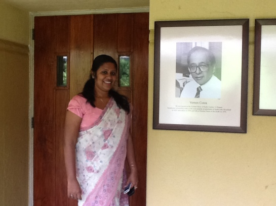 One of Sri Lanka's top radio producers Indira Priyadarshini Nawagamuwa of the Sri Lanka Broadcasting Corporation with the picture of legendary Sri Lankan broadcaster Vernon Corea.
