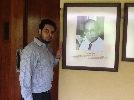 Chrismarlon Perera of the Radio Ceylon Facebook Group with the framed picture of the pioneering broadcaster of Radio Ceylon/Sri Lanka Broadcasting Corporation, Vernon Corea.
